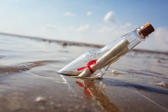 Message in a bottle. Washed up on a beach concept for help, sos, emergency and assistance Royalty Free Stock Image