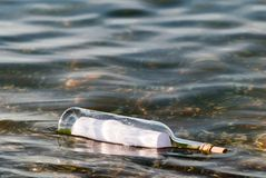 Message in a bottle in the water Stock Photo