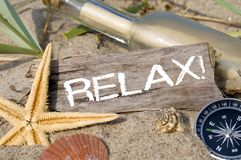 Message in a bottle with wood, chalkboard and maritime decoration royalty free stock photography