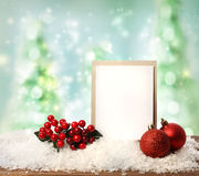 Message card with Christmas ornaments. Message card with red ornaments over Christmas tree background Royalty Free Stock Photo