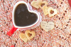 Message close to a red cup of tea: I will be waiting for you tonight Stock Image