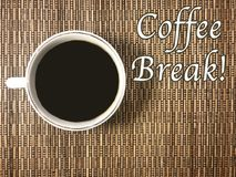 The message that Coffee Break with a cup of coffee on the wicker background. The message that Coffee Break with a cup of coffee on wicker background . On the Stock Photos