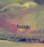 message coloré de scintillement de plume d'amour Photographie stock