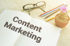 Message about content marketing on business book. Stock Image