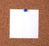 Message on cork board. Blank message paper pinned to cork board Stock Image