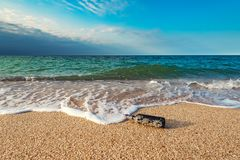 Message in a corked bottle on the empty beach. A message in a corked bottle on the empty beach stock photography