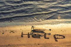 Message in a corked bottle on shore, hope of salvation royalty free stock photography