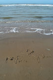 Message d'amour à la plage Images stock
