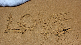 Message d'amour écrit en sable Photo libre de droits