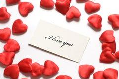 Message d'amour et petits coeurs autour Images libres de droits