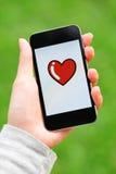 Message d'amour sur l'écran de téléphone portable Photo libre de droits