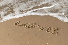Message d'amour sur le sable de plage Photos libres de droits