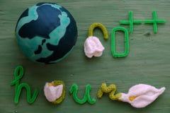 Message d'heure de la terre sur le fond vert Photos libres de droits