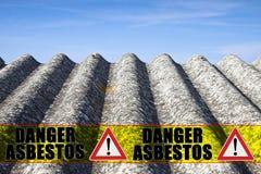 The message `danger asbestos` written on a yellow stripe.  Royalty Free Stock Photos