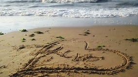 Message dans le sable Photo stock