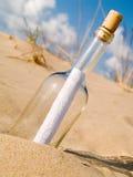 Message dans une bouteille Photo stock