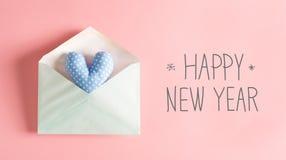 Message de bonne année avec un coussin bleu de coeur Photo stock