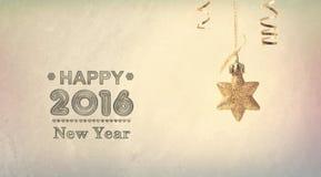 Message 2016 de bonne année avec une étoile accrochante Photo stock