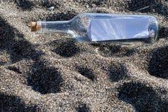 Message de bouteille Photo stock