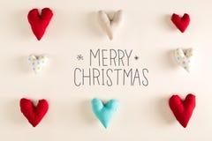 Message de Joyeux Noël avec les coussins bleus de coeur Photos stock
