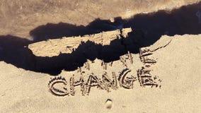 Message de sable de mouvement lent de dommages de changement climatique banque de vidéos