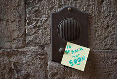 Message on the doorbell Stock Images