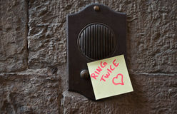 Message on the doorbell Royalty Free Stock Photos