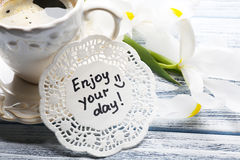 Message Enjoy your day with cup of coffee and beautiful flowers Royalty Free Stock Photo