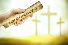 The message of forgiveness from the cross. A hand that shows the message of forgiveness from the cross of the Lord Jesus. Jesus blood cries out with a message of royalty free stock photo