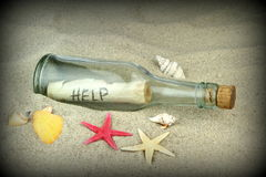 Message in a glass bottle. Close up image Stock Photos