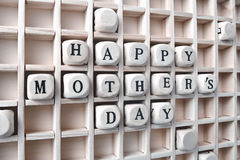 Message happy Mothers days made with building wooden blocks in s Royalty Free Stock Images