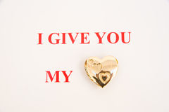Message: I give you my heart. A simple message ' I give you my heart ' with heart replaced by a gold heart shaped locket. The image is in red text on a plain stock illustration