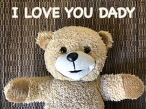 The message that I LOVE YOU DADY by cute teddy bear. On wicker background especially for mothers day Stock Photography