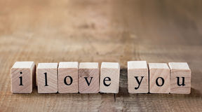 Message I love you spelled in wooden blocks Royalty Free Stock Photos