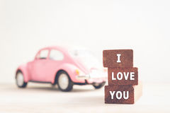 Message I love you on wooden blocks and car with copy space Royalty Free Stock Photography