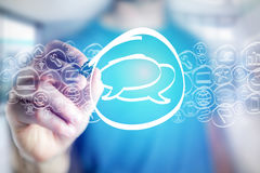 Message icon being drawn by a man on a virtual interface - techn Stock Photography