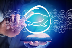 Message icon going out a smartphone interface - technology conce Stock Photo