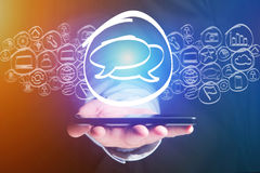 Message icon going out a smartphone interface - technology conce Stock Images