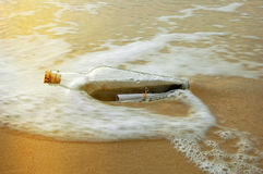 Message In A Bottle At Sunset Royalty Free Stock Photos