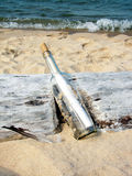 Message In A Bottle On Driftwood Royalty Free Stock Photos