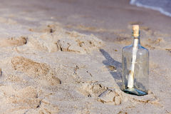 Message ina bottle. Help message in a bottle on beach Royalty Free Stock Photography