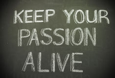 Message 'keep your passion alive' written in white chalk on blac Royalty Free Stock Photos