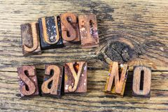 Just say no message letterpress. Message letterpress just say no drugs alcohol letterpress type letters wood block sign concept inspiration Royalty Free Stock Image