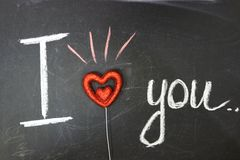 Message of love. The inscription on the blackboard with chalk. stock image