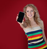 Message on mobilephone. Beautiful woman holding mobilephone towards camera Royalty Free Stock Photos