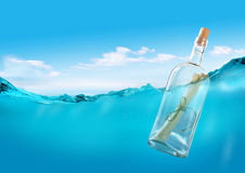 Message in the ocean. Bottle with a message in the ocean Royalty Free Stock Images