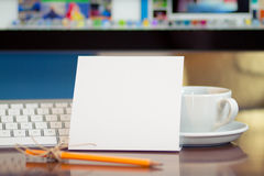 Message on the piece of paper. PC display and coffee cup at background Royalty Free Stock Photo
