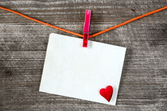 Message and red heart on the clothesline Royalty Free Stock Image