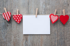 Message and red hearts on the clothesline Royalty Free Stock Images