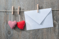 Message and red hearts on the clothesline Royalty Free Stock Image